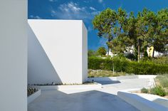 nuno montenegro architects troia MED portugal designboom. the garden surrounding the property does not have a clearly defined boundary