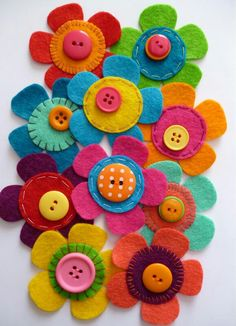 Felt flowers with buttons sewing inspiration. / paper-and-stringGreat for clippies Flores de feltroFelt flowers with button centers Great way to get kids started with sewing!paper-and-string: sample making. Teach the kids simple stitches and button s Button Flowers, Felt Flowers, Diy Flowers, Fabric Flowers, Colorful Flowers, Beautiful Flowers, Button Art, Button Crafts, Fabric Crafts