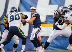 """Phillip Rivers #17 (QB) for the S.D. Chargers in Preseason week 1 vs. Seahawks.  Also pictured Jesse Williams #90 """"Tha Monstar"""" (DT), and Charger King Dunlap (OT)"""