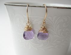 Rich AAA amethyst wrapped with 14k gold filled wire. Classic and understated, these beauties will add a touch of sparkle to any occasion.    All metal components hand formed from 14k gold filled wire. Delicate and lightweight at ½ of an inch in length.