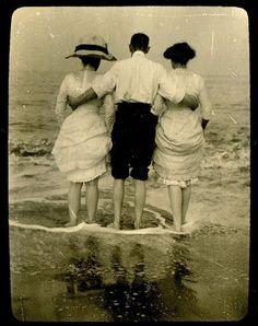 Friends walking in the sea.