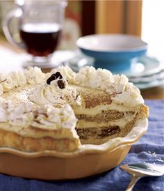 "TIRAMISU PIE  1 prebaked 9"" pie crust  Filling  3 cups brewed strong coffee or espresso  10 large egg yolks  10 T sugar  1 lb mascarpone cheese  Kahlúa to taste  2 cups heavy cream  24 ladyfingers  Garnish:  2 cups Whipped Cream   Cocoa powder"