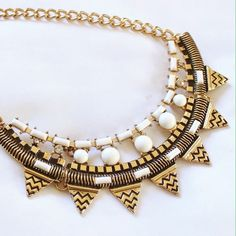 """⚜Host Pick!⚜ {Zad} Gold and Cream Bib Necklace Beautiful bib necklace made with gold metal and resin beads. Measures 16 to 18"""" long and the bib is 1.5 by 4.5"""". Perfect for a cocktail party with a LBD. Offers always welcome! Zad Jewelry Necklaces"""