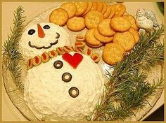 Cheeseball snowman with veggies and crackers; Makes a great holiday treat for your guests! by SAburns