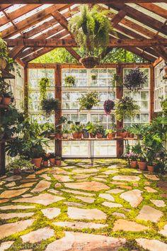 Moss and stone floor, windows, hanging plant poles Backyard Greenhouse, Greenhouse Plans, Backyard Landscaping, Dream Garden, Home And Garden, Garden Living, Rustic Greenhouses, Decoration Plante, My Secret Garden