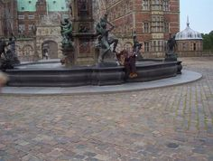Frederiksborg Castle -Denmark   I'M PRETENDING TO DRINK FROM THE FOOT OF THE FOUNTAIN  OUTSIDE THE QUEEN'S SUMMER CASTLE-JUNE 2005-BY DEBBIE