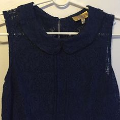 Vera Wang Top Great condition. Sheer. Color is navy blue. Beads around the collar. Vera Wang Tops Blouses