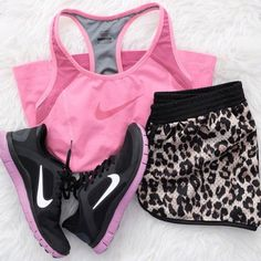 Nike Women's Gym Clothes. Pink Sport bra, leopard print shorts and Pink Nike running shoes. http://www.FitnessApparelExpress.com