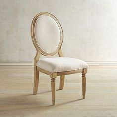 Invite this charming French-inspired chair to dinner or as a sophisticated addition to any living space. The Emery Side Chair boasts a lovely oval back and upholstered seat and backrest, making it easily the best seat in the house. It's part of the Magnolia Home Collection by Joanna Gaines.