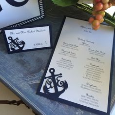 Custom menus and place cards matching the nautical themed invitation set