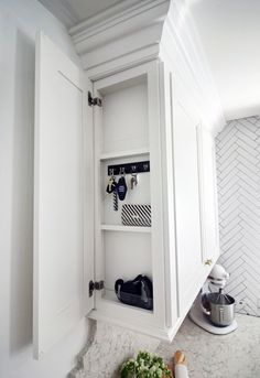 A clever door on the side of this cabinet hides a message center with a pocket for mail and hooks for keys. If you're notorious for always misplacing your car keys, you need this. See more at Hunted Interior »