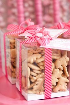Elephant cracker party favors. Love the cute packaging! Striped pink ribbon