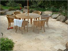 Travertine patio with boulder border