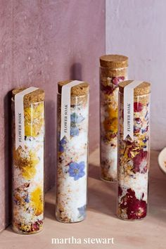 This fragrant bath soak combines dried roses, calendula, and blue cornflowers with essential oils and mineral-rich Epsom and pink Himalayan salts to melt stress. To adorn the vials, put drops of water on whole blooms to stick them to the inside of the glass, then fill, cork, and seal with our custom labels. #marthastewart #crafts #diyideas #easycrafts #tutorials #hobby