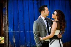 Edgy engagement photo against a blue wall. #engagement #photoshoot #cool