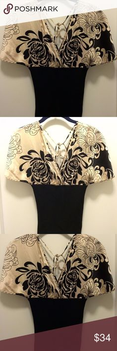 "bebe - Gold & Black Blouse with Black Floral - S bebe - Gold and Black Blouse with Black Floral - Size Small Only One In-Stock!  Condition: •Super Nice! Super Trendy Blouse!  •Excellent Used Condition!  •No Stains! No Color Fading!    •No Holes! No Rips! No Tears!   Details: •bebe •Gold & Black Blouse with Black Floral  •Size Small •Super Soft Silk-like Material on the top portion  Measurements: •Length: 24"" •Width/Bust: 16-18"" •Width/Waist: 12-13"" •All measurements are with the garment laid…"