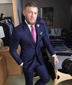 "Conor McGregor Wears David August Collab ""F*ck You"" Pinstripe Suit for Mayweather vs McGregor World Tour 