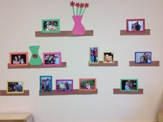 Just a great way to display children's family photos using construction paper and some imagination. I have it displayed in the classroom's  home living area!