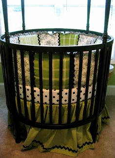 Round crib...love!---I couldnt find any round cribs when I was pregnant with my daughter, I love them, I love that not many people have them <3 AND THIS ONE....OMG my favorite color is green and Im obsessed with polka dots :) Im in Heaven!!!! If my husband and I ever have another baby I want this exact set up!!!!!!!!!