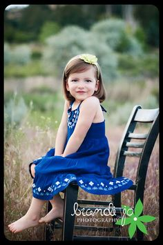 Adorable little girl!!! Love this pose with the chair and her bare feet. www.BrandiJoPhotography.net
