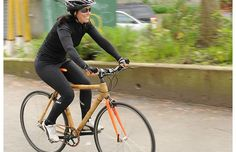Cycling columnist Kay Cahill poses with a bamboo-framed bike from Grass Frames near Vancouver's Main Street. The company's ethos is to use natural products, source local materials and reuse and recycle whenever possible.