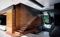 Elegant wodden staircase with suspended wires, Cape Town, by SAOTA Stefan Antoni Olmesdahl Truen Architects.
