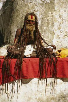✭ A Hindu holy man with streaming dreadlocks at prayer in Bodhnath, Nepal
