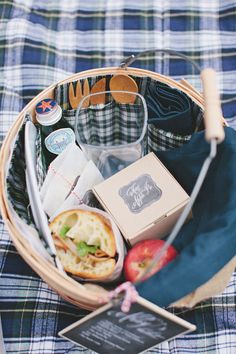 the sweetest picnic basket stuffed to the gills with yummy essentials  Photography by rebeccahansenweddings.com