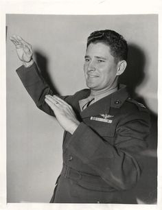"""1943- Capt. Joseph Foss, highest-ranking """"Ace"""" of WWII and Congressional Medal of Honor recipient, describes one of his air battles for reporters in a press interview at the Waldorf-Astoria Hotel."""