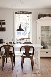 Loft living, industrial chairs,  armoire as kitchen cabinet, industrial lamp.