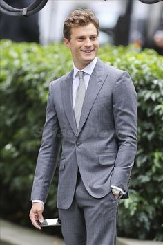 Entertainment Tonight - News - Jamie Dornan Bulges Out During 'Fifty Shades of Grey' Reshoots (Oct 13 Fifty Shades Cast, Fifty Shades Trilogy, Fifty Shades Of Grey, Jamie Dornan, Cristian Grey, Mr Grey, Gray, Tailored Suits, Gentleman Style