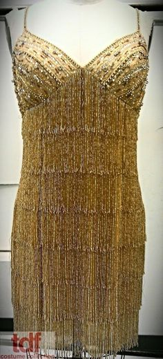 The dress from Smokey Joe's Café that was covered in fringe and made it weigh what felt like 30 lbs. This beaded fringe dress is the opposite! It's light as a feather and has beautiful movement. The gold is stunning in the light too! #TDFCC #KeepingUpWithTheCostumes #1960s