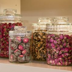 Floral Teas on Display....Fragrant floral teas find a handsome home in glass canisters, where their soft hues are on full display.    Simply fill your favorite jars with colorful varieties of loose tea petals -- we like chamomile, violet, red rose, jasmine, jasmine-scented flowering, and plum berry teas -- and arrange together for a striking counter adornment.