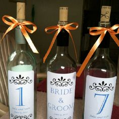 Use wine bottles for table numbers...just soak off old label and create your own.