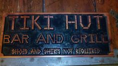 Created with cedar wood, black spray paint and a cnc machine was used to cut it out. Create a custom sign that says anything you want it to. Done at Big Kahuna Signs and Apparel in Hilton Head Island.