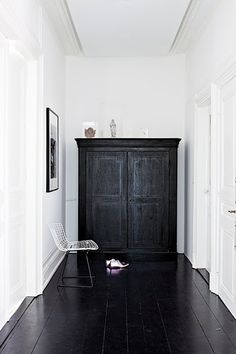 Black wooden floor and cabinet
