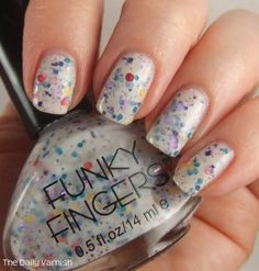 "Funky Fingers Jawbreaker from thedailyvarnish.com. . ""Jawbreaker has a slew of different colors and sizes of glitter suspended in a white with a good bit of a gray undertone semi sheer base."""