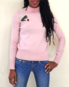 How cute is this baby pink #cashmere sweater for the cold winter months? Love the squirrel detail!