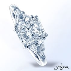 Style 7312 Platinum and diamond ring classically designed with a 1.71 ct radiant diamond center embraced by perfectly matched trapezoid and tapered baguette diamonds.