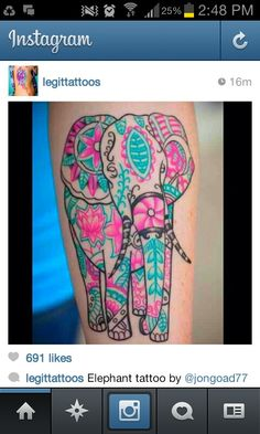Elephant tattoo in pink and turquoise. I dont think i would go for color ink though, just because of fading and touch up issues. beautiful though!