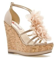 I LOVE these!!!  The wedge is so comfortable to wear and I really like the fun, fancy flowers too.