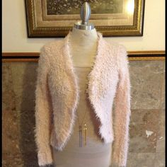 Super chic sweater New with tags super chic sweater. PERFECT FOR THE TIME OF YEAR Cotton Emporium Sweaters