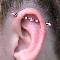 I did an industrial piercing for this gal last December, and today I got to help switch up the gems on her @anatometalinc barbell to a new color combo! She took great care of her ear and it healed beautifully  #saintsabrinas #neilmedpiercingpro...