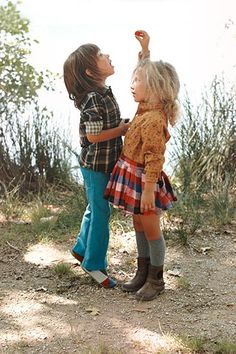 I seriously love that little girl's plaid skirt and button up. My style for sure haha