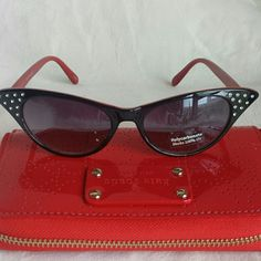 NEW! Stylish Cat-Eye Sunglasses New, Unworn  Black outer frames with a cherry red interior  Crystal embellishments on the temples UV protection   Feel free to ask questions. I'd love to find a great home for these glasses. Accessories Sunglasses
