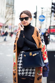 Mira looking gorgeous on the street in a mix of prints. #LFW