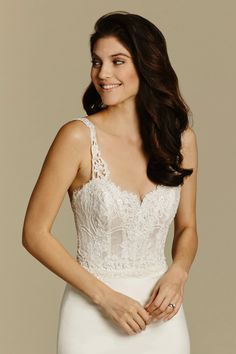 Ivory crepe trumpet bridal gown, scalloped sweetheart bodice with Venise lace straps, Alencon lace hem detail and chapel train.