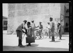 Palestine events. The 1929 riots, August 23 to 31. Inhabitants searched for arms at city gates. A Jew searched at Jaffa Gate by Palestine Police