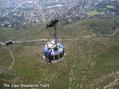 "The Table Mountain Aerial Cableway is a cableway to the top of Table Mountain.  It is one of Cape Town's most popular tourist attractions with approximately 800,000 people a year using the cableway. The ""Rotair"" cars installed in 1997 and carry 65 passengers each;  the floors of the cars rotate through 360 degrees during the ascent or descent, giving passengers a  panoramic view."