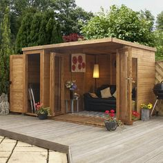 Wooden summer house with side shed.